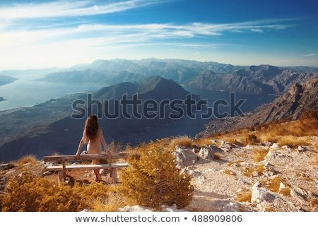 Kotor bay. Montenegro. Romantic Woman on bench above Landscape o Stock photo © Victoria_Andreas