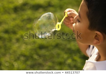 Happy children playing with bubbles outdoor, selective focus - kids in motion Stock photo © zurijeta