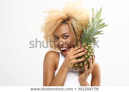 Fiatal lány harap ananász profil közelkép portré Stock fotó © deandrobot