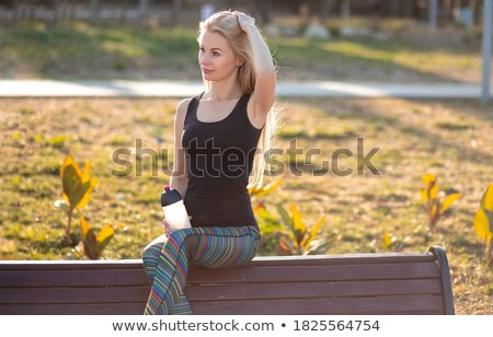 female sitting on bench wearing sportive outfit stock photo © dash