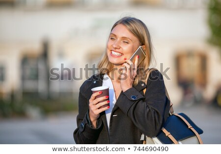 komoly · autentikus · nő · beszél · mobiltelefon · utca - stock fotó © stevanovicigor