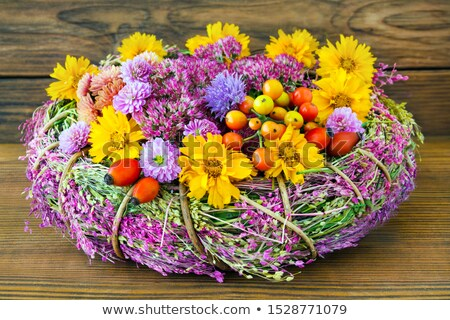 fall greeting with yellow autumn flowers on wooden table stock photo © tasipas