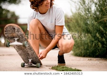 fit woman smiling while tying shoelace stock photo © wavebreak_media