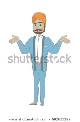 Hindu confused businessman with spread arms. Stock photo © RAStudio
