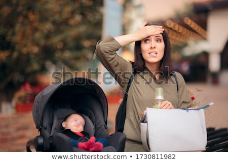 mother in car holding baby Stock photo © IS2