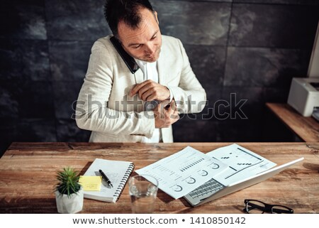 A business man doing up his cuffs Stock photo © IS2