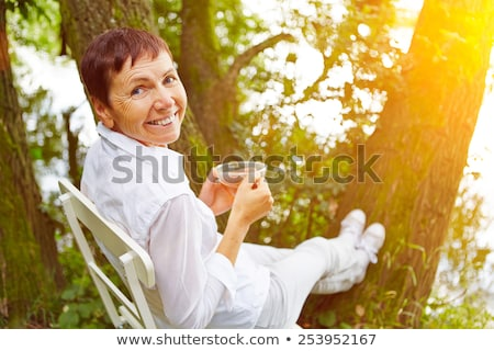 Сток-фото: наслаждаться · чай · время · саду · счастливым · жизни