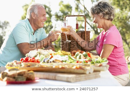 casal · de · idosos · alimentação · potável · piquenique · verão · fruto - foto stock © is2