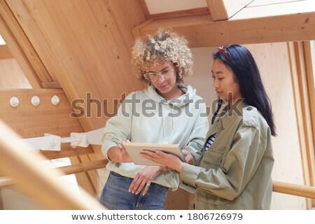 zakenvrouw · bespreken · blauwdruk · architect · kantoor · vrouw - stockfoto © wavebreak_media