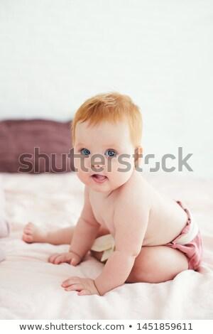 Vonzó aranyos lány ágy piros bugyik Stock fotó © fotoduki