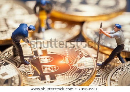Worker with Coin Mining Stock photo © bluering