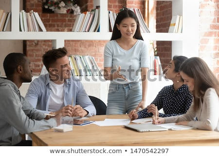 Young man teacher shares knowledge with students Stock photo © vectorikart