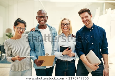 grupo · sonriendo · jóvenes - foto stock © deandrobot