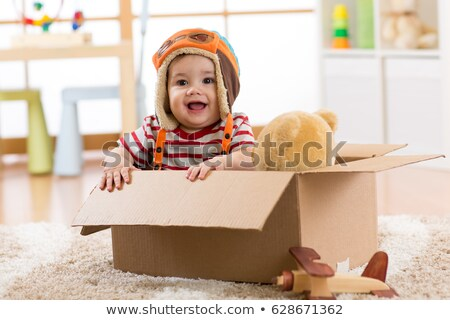 happy little boy in pilot hat playing at home Stock photo © dolgachov