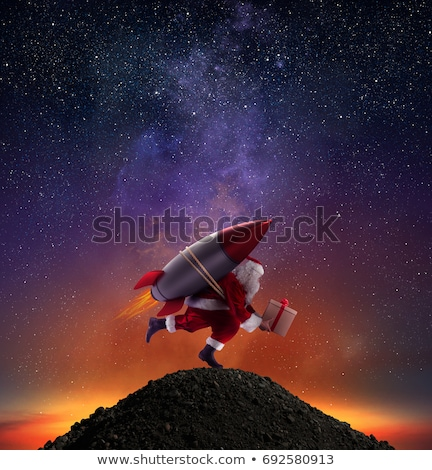 fast delivery of christmas gifts ready to fly with a rocket stock photo © alphaspirit