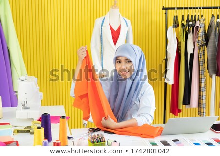 Arab women orange Hijab_desk work Stock photo © toyotoyo