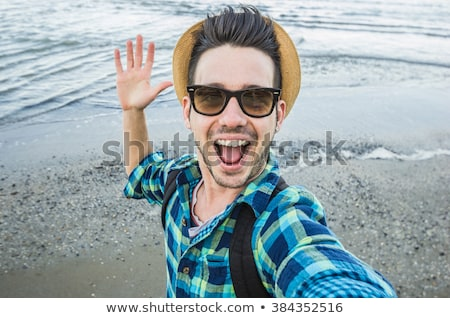 portrait of an excited young man in straw hat stock photo © deandrobot