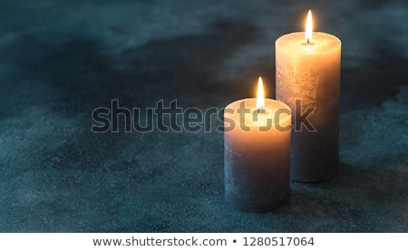 two burning candles on navy blue background stock photo © alex9500