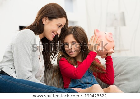 mother and daughter holding piggybank stock photo © andreypopov