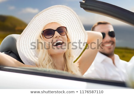 happy woman in convertible car over big sur coast Stock photo © dolgachov