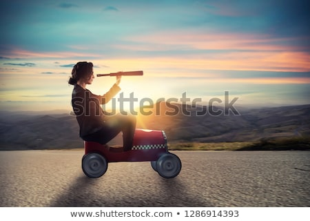 Businesswoman with telescope on a car looks for new business opportunity. Isolated on white backgrou Stock photo © alphaspirit