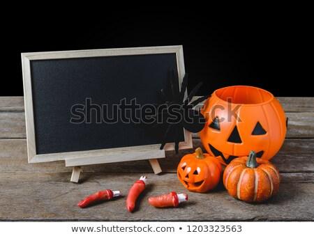 blank chalkboard and halloween pumpkins stock photo © dolgachov