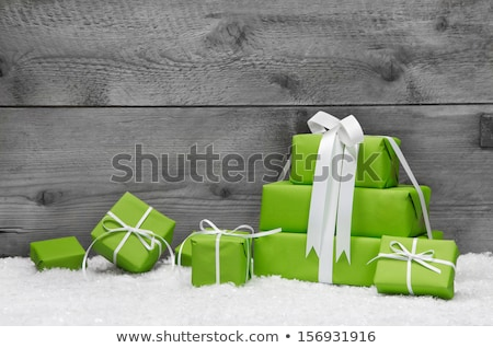 white gift box with a bow on a gray wooden background Stock photo © mizar_21984