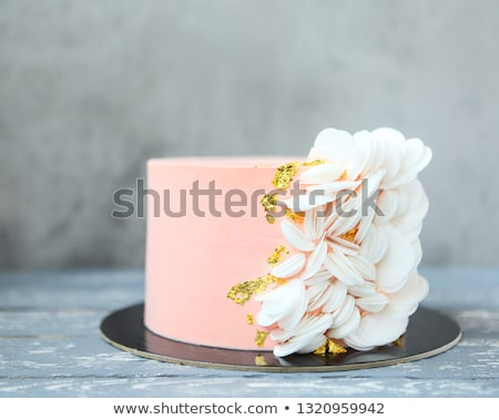 Pink wedding cake with wafer paper and gold decor Stock photo © dashapetrenko