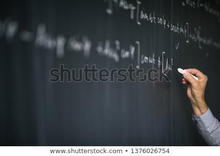 Math teacher by the blackboard during mathclass - detail of the  Stock photo © lightpoet