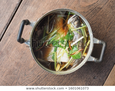 Soup with green vegetables and sea bass. Stock fotó © zoryanchik