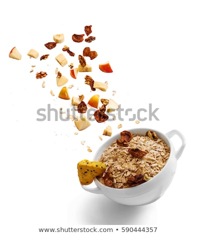 Falling homemade cookies walnuts on a white background. Stock photo © artjazz