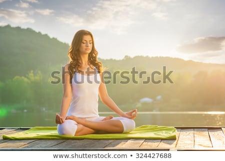 Nő jóga pihen móló naplemente égbolt Stock fotó © Lopolo