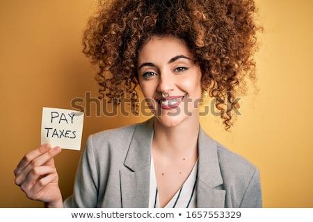 Retrato encantado jovem cabelos cacheados cartão de crédito Foto stock © deandrobot