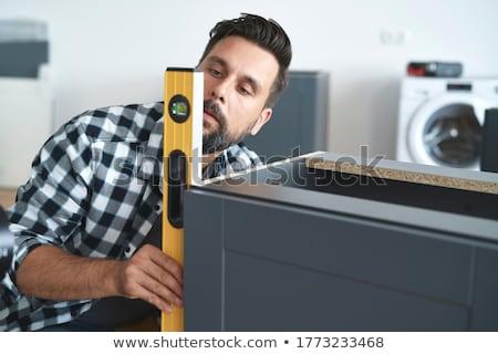Using level check handtool Stock photo © pressmaster