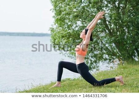 Hilâl poz kıyı açık havada konsantre Stok fotoğraf © pressmaster
