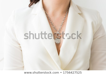 close up of woman in white with pearl earring Stock photo © dolgachov