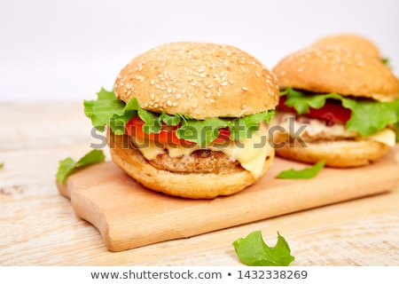 Stock photo: Craft beef burger  on wooden table on light background