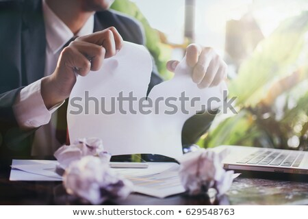 Frustrated office manager tearing document. Stock photo © lichtmeister