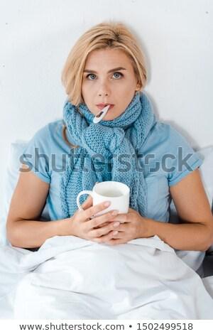 Triste malade femme écharpe maison personnes Photo stock © dolgachov