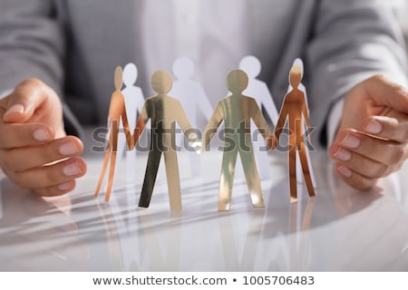 Person Protecting Paper Cut Out Figure Stock photo © AndreyPopov