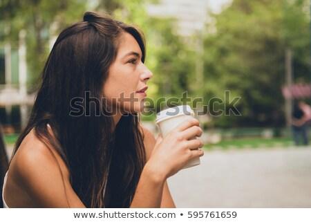 Dromerig jonge vrouw beker koffie buiten vrouw Stockfoto © galitskaya
