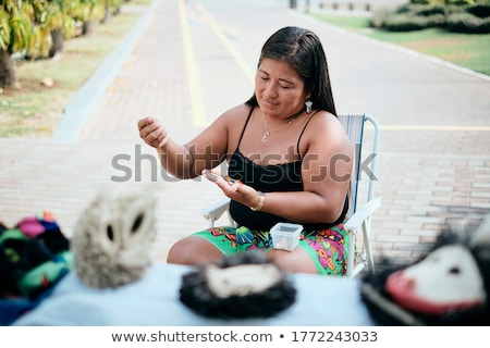 Indigenous Woman Beading Flower Coaster At Market Stall For Tourists Stock photo © diego_cervo