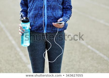 Jonge vrouw sportkleding najaar park fitness sport Stockfoto © dolgachov