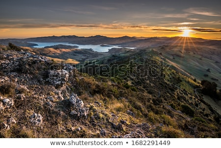 Sunset, sea and mountains Stock photo © fyletto