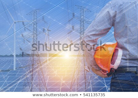 electricity pillars and wind turbines on sunset stock photo © elly_l