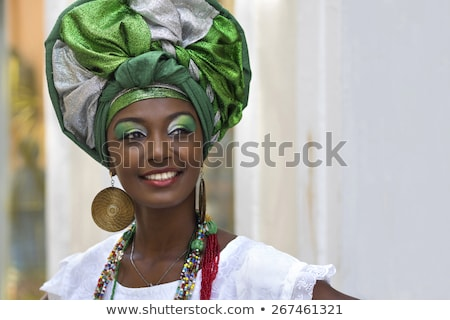happy woman black dressed with necklaces Stock photo © imarin
