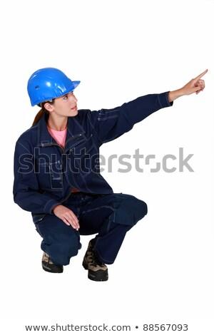 Tradeswoman pointing sideways Stock photo © photography33