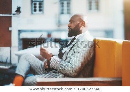 Handsome business executive tilting Stock photo © stockyimages