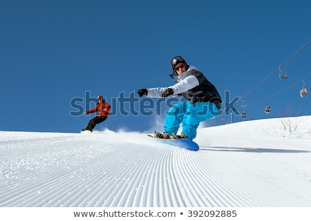 férfi · snowboard · lefelé · domb · tél · utazás - stock fotó © photography33