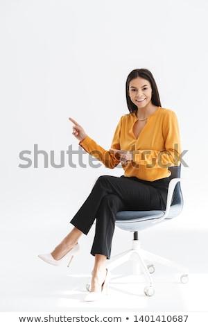 kadın · oturma · ofis · koltuğu · yandan · görünüş · güzel · genç - stok fotoğraf © feedough